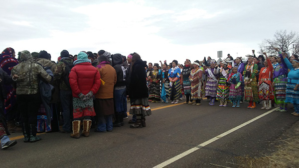 About 200 people came out onto the road Saturday afternoon for a prayer walk/dance ceremony/drum circle that would provide a presence on the road while some of the elders went to talk with  police about the police moving the blockade.​