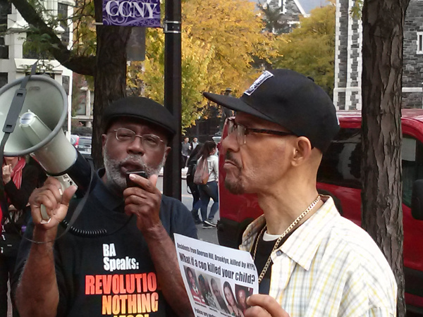 Carl Dix and Nicholas Heyward at CCNY rally, November 3.