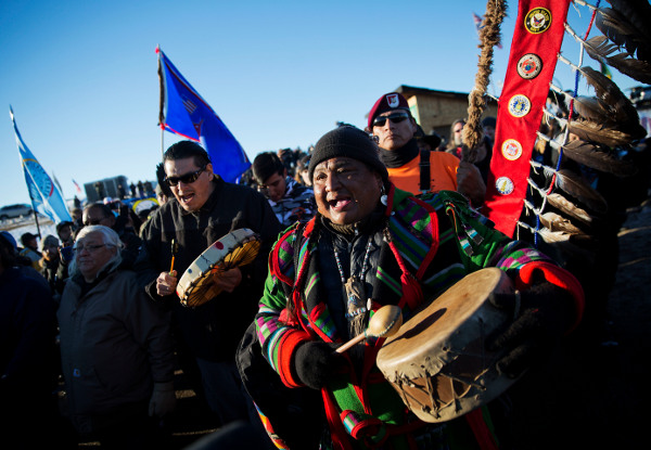 Procession through the Oceti Sakowin camp after it was announced that the U.S. Army Corps of Engineers won't grant easement for the Dakota Access oil pipeline, December 4, 2016. (AP photo)