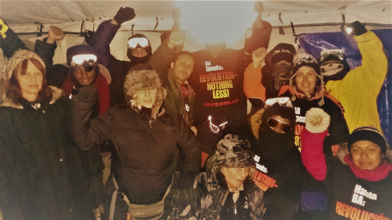 Revolution Club delegation in their tent at Standing Rock