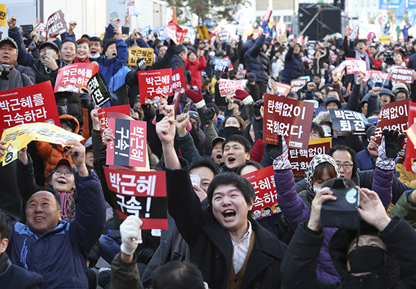 Protesters in front of the National Assembly, Seoul, Korea, celebrate after hearing of President Park Geun-hye's impeachment, December 9.