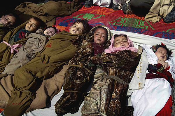 The bodies of Afghan children who were killed by a U.S.-led NATO airstrike which killed several Afghan civilians, including ten children April 2013.  (Photo:AP)