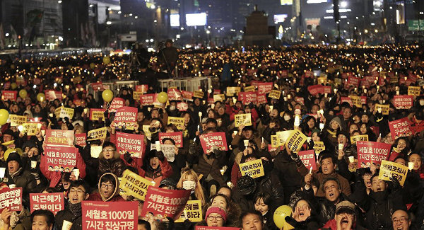 Protesters call for impeached President Park Geun-hye to step down during a candle light vigil in Seoul, South Korea, January 7.