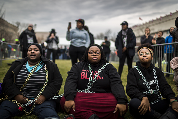 People from Black Lives Matter chain themselves to protest Donald Trump, Washington, DC, January 20.