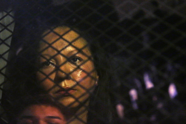 Guadalupe Garcia de Rayos, a 36-year-old mother of two children who came to the U.S. with her parents at the age of 14, being held in a van that was blocked for several hours by protesters, after her arrest at an immigration office in Phoenix, February 8.