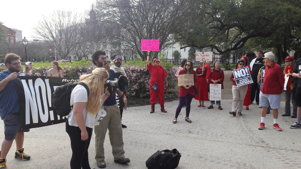 The Drive Out Trump/Pence Regime Tour is in New Orleans, where they marched on International Women's Day.