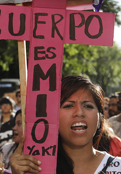 Yakiri Rubio, charged with murder for defending herself from a rapist, leads an International Women's Day march in Mexico City, 2014.