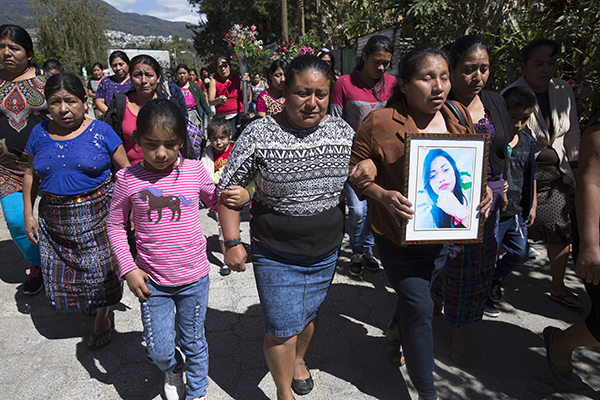 Funeral procession for one of the girls who perished in the fire at the children's shelter near Guatemala City.
