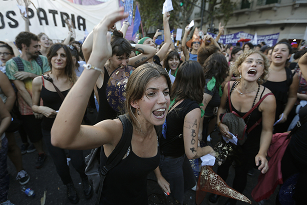 "In Buenos Aires, Argentina, tens of thousands were part of the Ni Una Menos (""Not one less,"" meaning not one more woman killed by violence at the hands of men.)"
