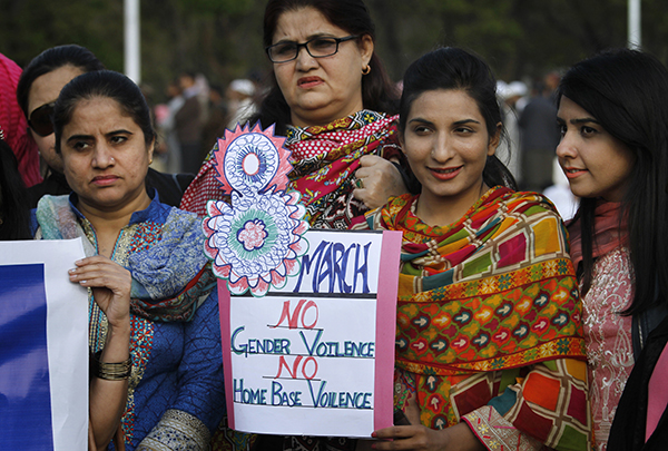 In Islamabad, Pakistan, women and men protested with signs calling for an end to attacks on women.