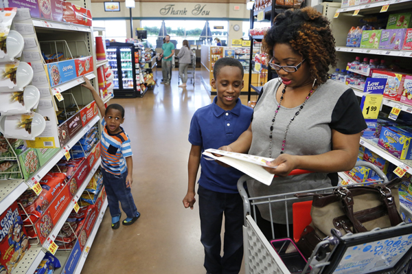 Family shops in Lafayette, Indiana, with Women, Infants and Children(WIC) checks for specific food items that meet certain guidelines. Trump's budget cuts will reduce funding for the Special Nutrition Program for WIC.