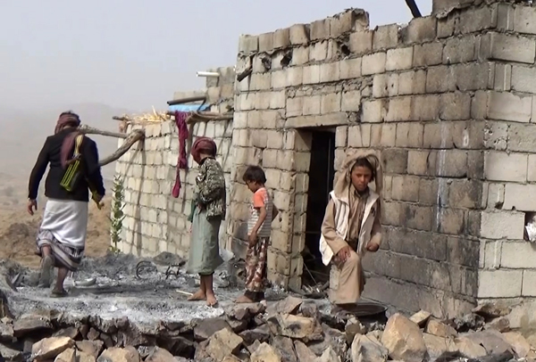 Residents inspect a house that was damaged during a January 29 U.S. raid on the tiny village of Yakla, in central Yemen.