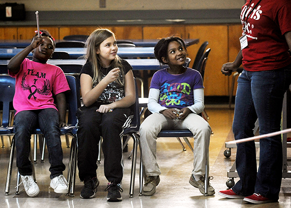 Trump's budget plan will cut $1.2 billion from funding after-school programs that involve more than 2 million kids.  Here kids in a Kentucky after-school program, 2012.