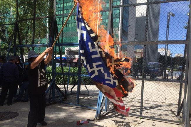 Burning the American flag at the U.S. Embassy, Mexico City, January 20, Trump's inauguration day.