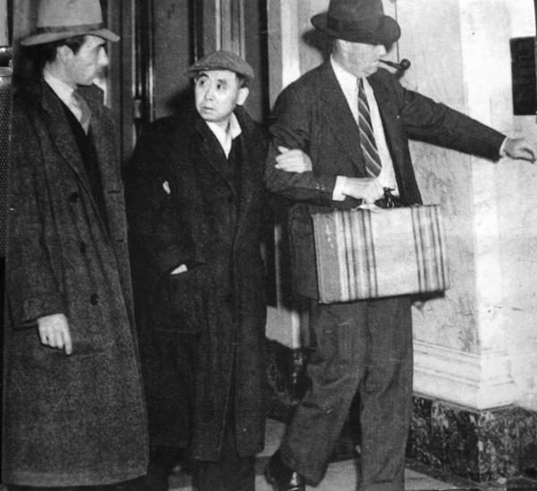 Japanese American community leader Sadiji Shiogi is lead away by FBI the day after the attack on Pearl Harbor.