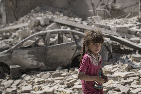 A young girl amid rubble in Mosul on July 2.