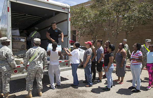 People from Beaumont, TX line up for water.