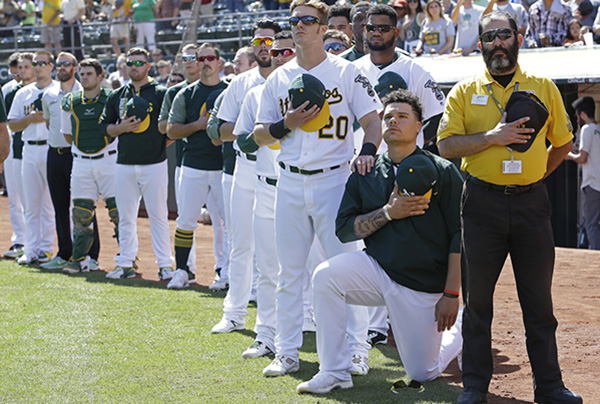 Bruce Maxwell of the Oakland A's is the first Major League Baseball player to take a knee.