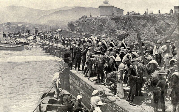 A U.S. invasion force commanded by Teddy Roosevelt lands at Santiago de Cuba.