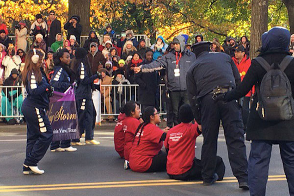 Sitting down in the street at the Thanksgiving Day Parade.