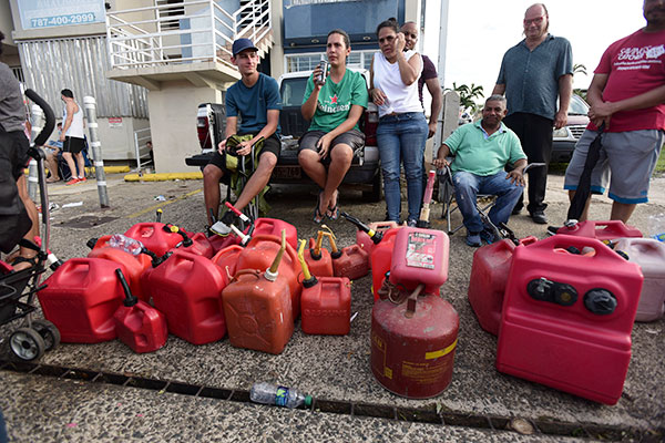 People in Puerto Rico wait in line for gas