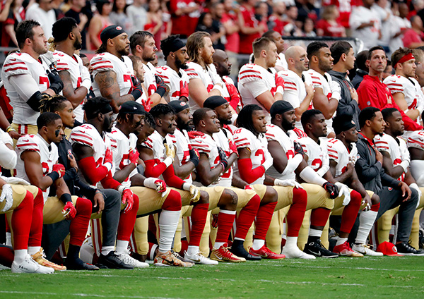 30 San Francisco 49ers take a knee on October 1.