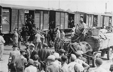 Jews from the Lodz ghetto being loaded onto freight trains for deportation to the Chelmno killing center. Lodz, Poland, between 1942 and 1944.