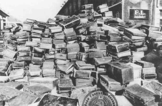 Suitcases that belonged to people deported to the Auschwitz camp. This photograph was taken after Soviet forces liberated the camp. Auschwitz, Poland, after January 1945.