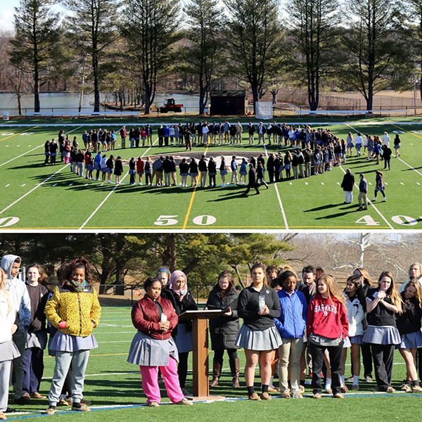 Students at John Carroll High School walk out and form a circle on the football field.
