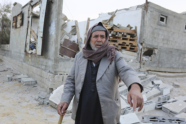 Palestinianinfrontof his home