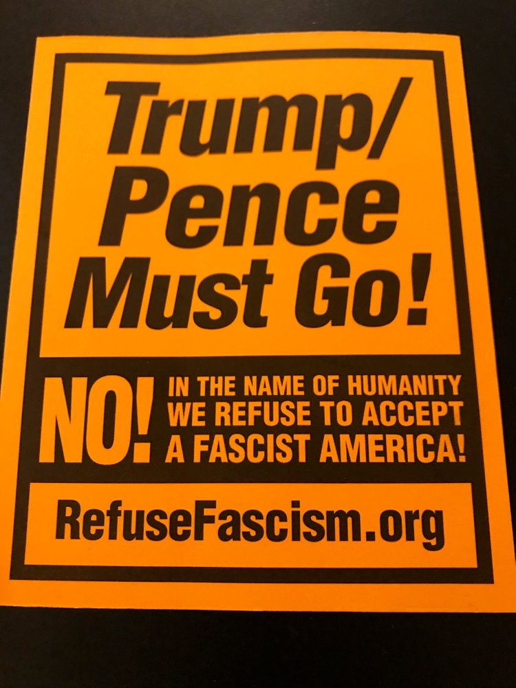Orange stickers 'Trump/Pence Must Go'