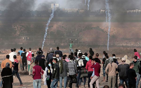"As thousands of Palestinians ran toward the barbed wire fence which imprisons them in the world's largest concentration camp, Israel again responded with massive violent—live fire, rubber bullets and a ""tremendous barrage of tear gas,"" April 27, 2018."