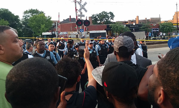 People on the Southside of Chicago face off against police in protest of another police murder.