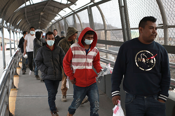 Immigrants from Mexico seeking asylum are turned back at the U.S.-Mexico border.
