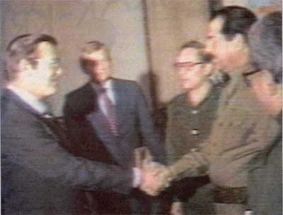 Saddam and Rumsfeld shaking hands in 1983